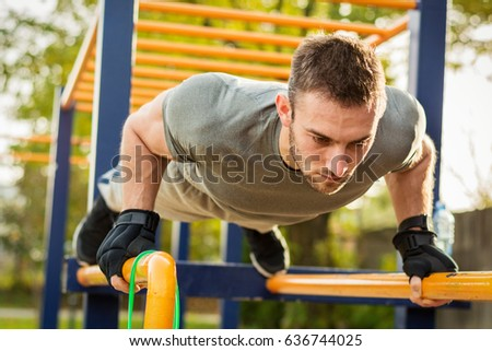 Push-ups - fitness man training push up outside in summer. #636744025