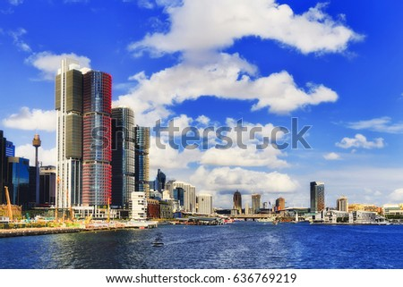 Sydney city Darling Harbour from new tall towers of Barangaroo to Pyrmont from mid Sydney harbour on a sunny day. Royalty-Free Stock Photo #636769219
