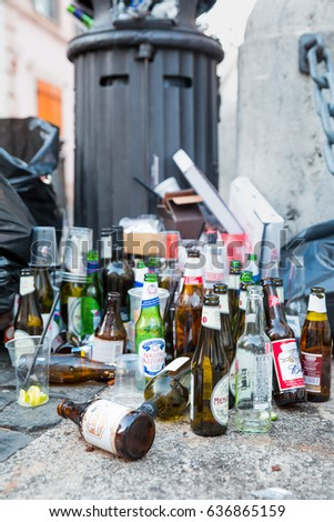 ROME, ITALY - MAY 07, 2017: Empty wine and beer bottles are dumped on a garbage pile after a street party #636865159