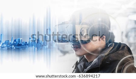 Businessman wearing virtual reality googles, with double exposure modern buildings technology #636894217