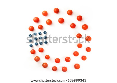 Cherry tomatoes and blueberries on white background, forming a frame for copy space. Culinary still life in colors of American flag. Independence Day or Memorial Day greeting card, 4th of July banner #636999343