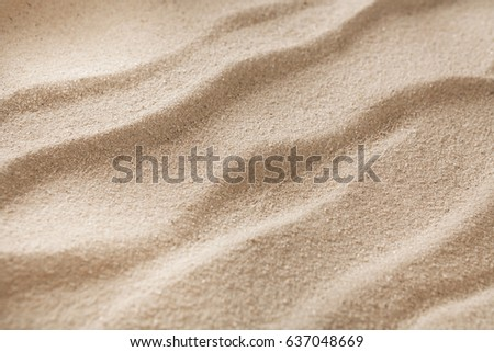 Beach wavy sand background. Natural seashore texture surface, closeup #637048669