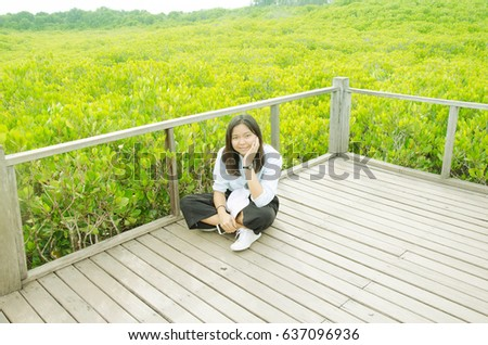 Asian woman in mangrove forest with wood bridge.focus on her face. #637096936