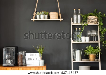 Modern kitchen with black wall, swing shelf and ladder bookcase #637113457