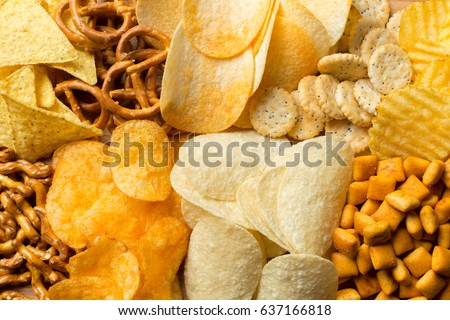 Salty snacks. Pretzels, chips, crackers Royalty-Free Stock Photo #637166818