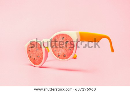 Beach sunglasses concept with watermelon on pink background
