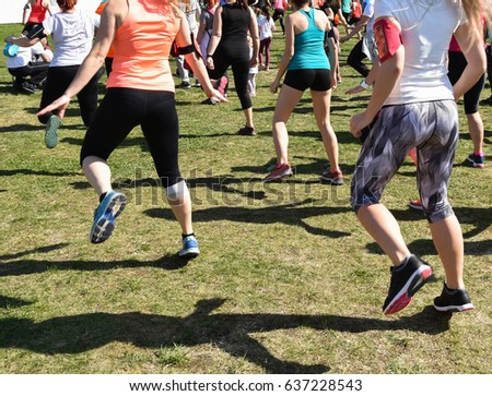 Women are warming up before running race #637228543