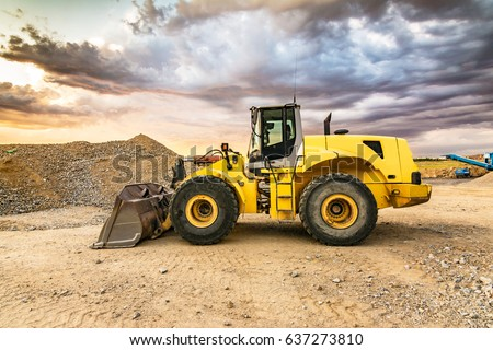Excavator on a road construction site #637273810