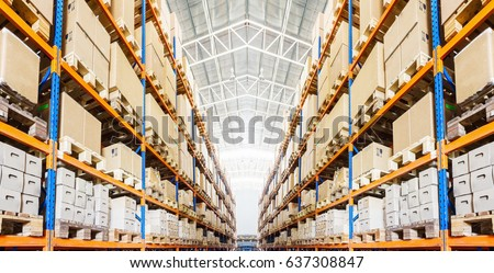 Rows of shelves with goods boxes in modern industry warehouse store at factory  warehouse storage Royalty-Free Stock Photo #637308847