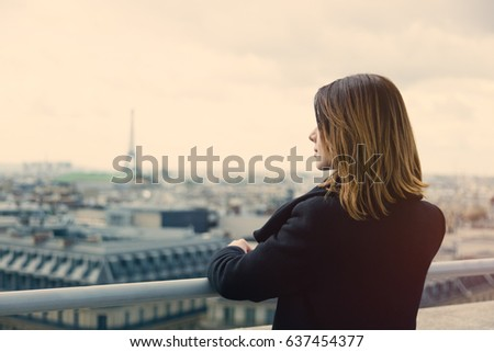 photo of beautiful young woman looking at the splendid view of wonderful Paris background #637454377
