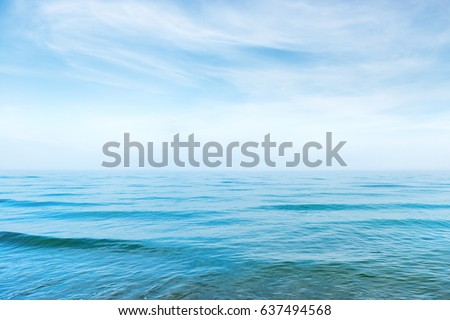 Blue sea water with waves and white clouds on the sky. Calm tropical landscape #637494568