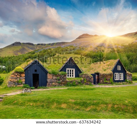 Tipical view of Icelandic turf-top  houses. Wonderful summer sunrise in the Skogar village, south Iceland, Europe. Beauty of countryside concept background.