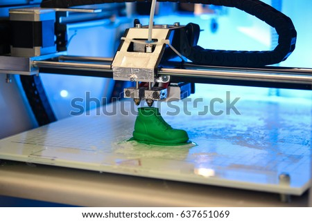 3D printer prints the form of molten plastic green close-up. Automatic three dimensional 3d printer performs plastic modeling in laboratory. Progressive modern additive technology #637651069