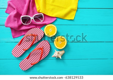 Summer fun time and accessories on blue wooden background. Mock up and picturesque #638129533