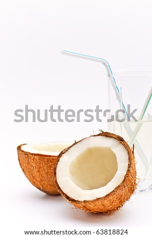 halves of coconut and glass with coco milk #63818824