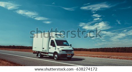 Light truck travel on europe road. Blue sky and autumn field panorama. #638274172