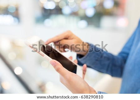 Woman working on cellphone #638290810