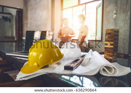 Business engineer contractor who contracts to supplies consulting about working their job at construction site office headquarters. Royalty-Free Stock Photo #638290864