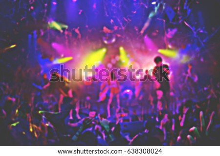 silhouettes of concert crowd in front of bright stage lights. #638308024