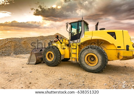 Excavator in the construction of a road #638351320