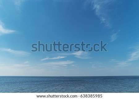 blue sky with soft fluffy white clouds,beautiful sky with white clouds on the lake ocean with water horizon background #638385985