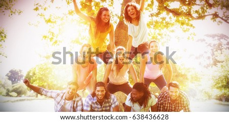 Happy friends in the park making human pyramid on a sunny day #638436628