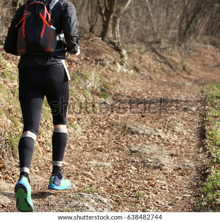 Leg of athlete runner during racing on the mountain trail in winter #638482744
