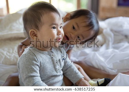 Two cute little baby having fun in the bed together #638517235