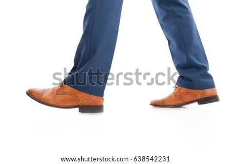 Side view of business man's elegant shoes walking as fashion and formalwear concept #638542231