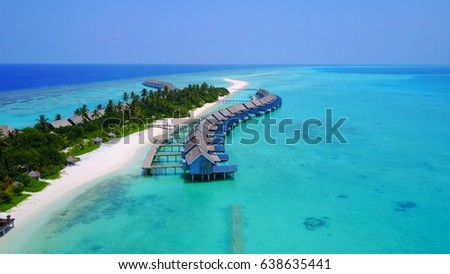 Aerial view of water bungalow and blue sea sky background in Maldives  #638635441