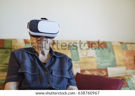 Old woman with virtual reality glasses #638760967