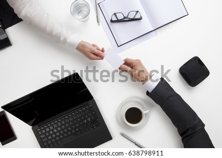 Business People Exchanging Visiting Card At Office Desk #638798911