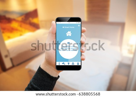 Man in bedroom reading notification of smart house system on his phone #638805568