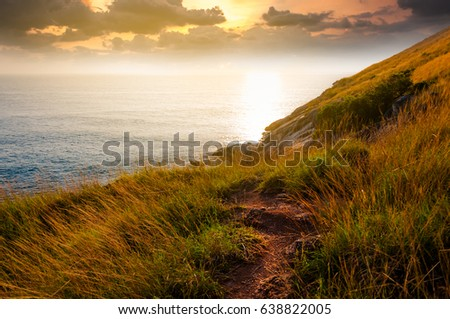 A secret pathway to beautiful unknown cliff during sunset nearby Naiharn beach in Phuket Thailand #638822005