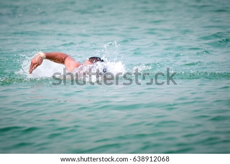 Handsome man enjoys swimming in the blue pool #638912068