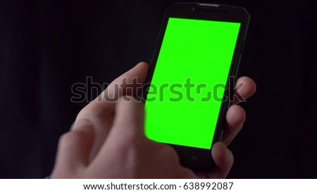Close-up of male hands touching of smartphone. Green screen Chroma Key. Close up. Tracking motion.