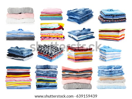 Stacks of folded clothes on white background Royalty-Free Stock Photo #639159439