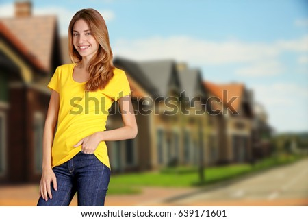 Young woman in stylish t-shirt on city street #639171601