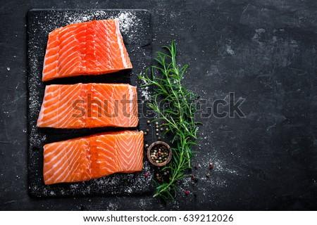 Raw salmon filet on dark slate background, wild atlantic fish #639212026
