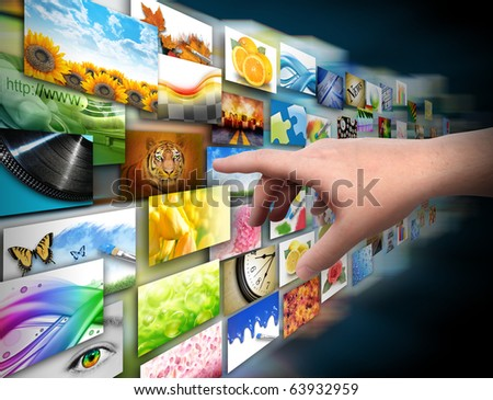 A hand is reaching out and touching a media gallery with photos on a black background.