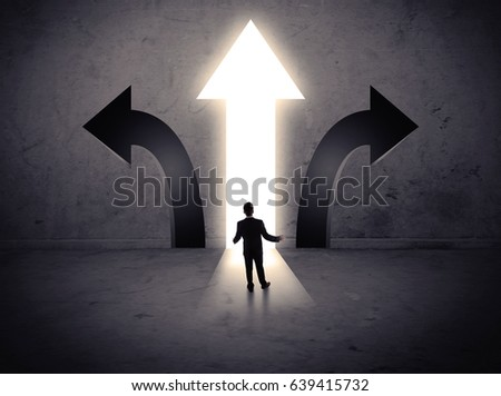 A businessman in doubt, having to choose between three different choices indicated by arrows pointing in opposite direction concept #639415732