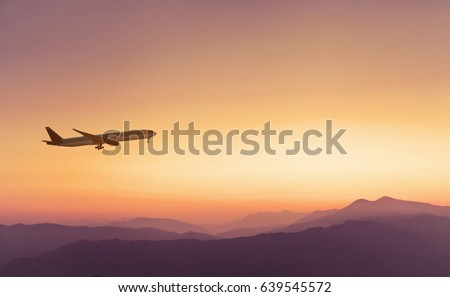travel concept background, airplane in sunset sky, international flight Royalty-Free Stock Photo #639545572