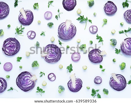 Fresh vegetables in a cut on a white background. Pattern from vegetables. Food background. Cut red cabbage.