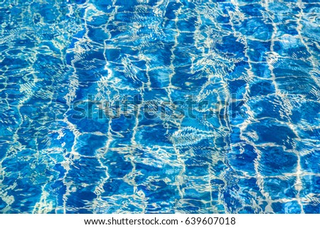 Blue color water in swimming pool rippled background #639607018