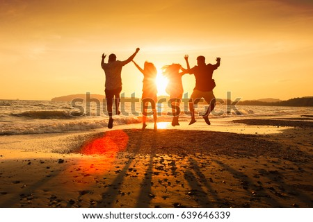 Asian family running on background of sunset beach and sea #639646339