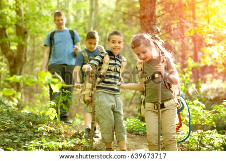 kids in green forest playing,concept of kids vacations and travel #639673717