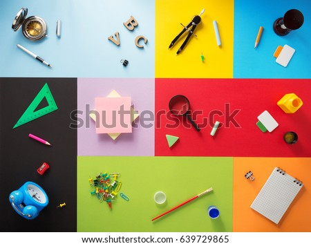 school supplies at abstract colorful background texture Royalty-Free Stock Photo #639729865