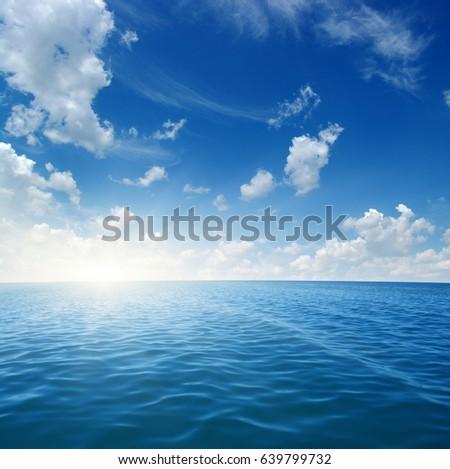 Blue sea and sun on sky #639799732