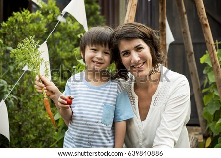 Kids having fun gardening outdoor #639840886