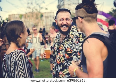 Group of Friends Drinking Beers Enjoying Music Festival together #639860263